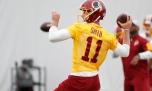 Jun 13, 2018; Ashburn, VA, USA; Washington Redskins quarterback Alex Smith (11) passes the ball during drills as part of veteran minicamp at Redskins Park. Mandatory Credit: Geoff Burke-USA TODAY Sports